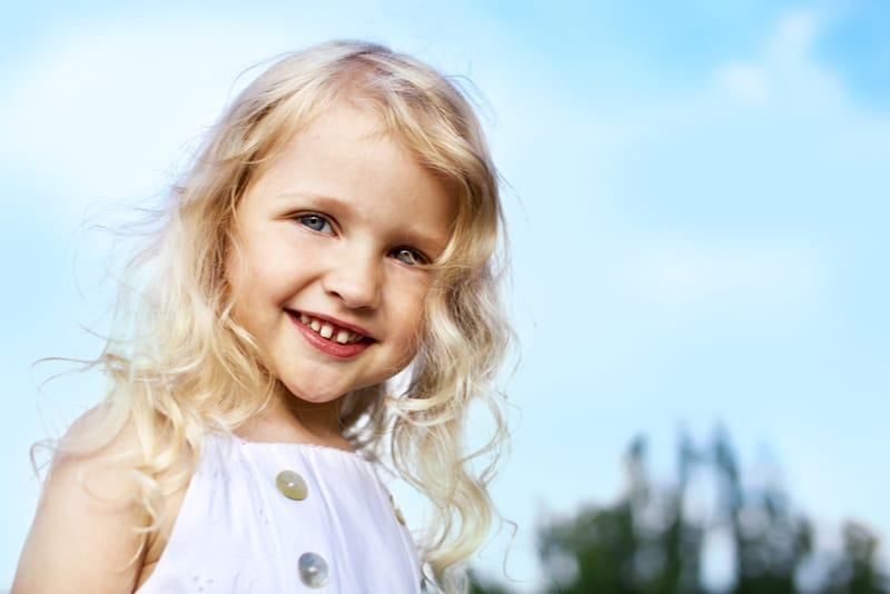 laughing little girl outdoors
