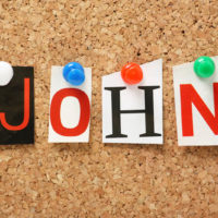 The name John in cut out magazine letters pinned to a notice board