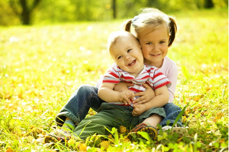 Cute siblings are playing in park