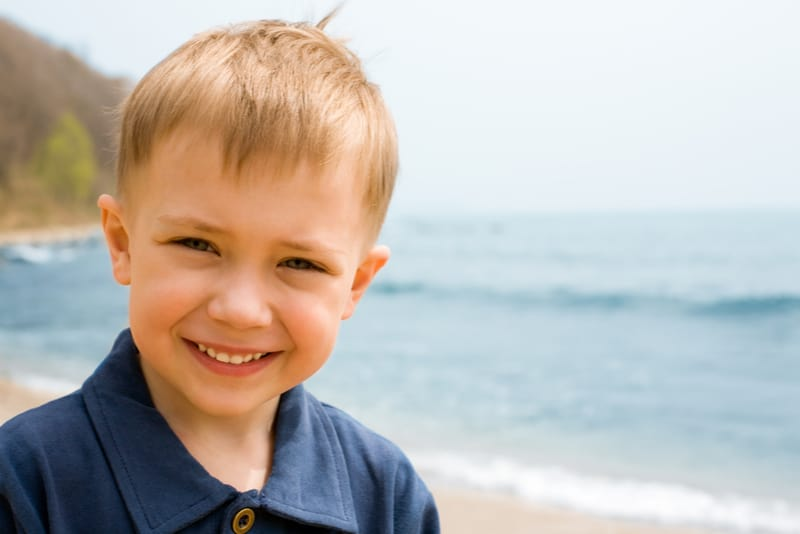 Smiling boy on a background of the sea