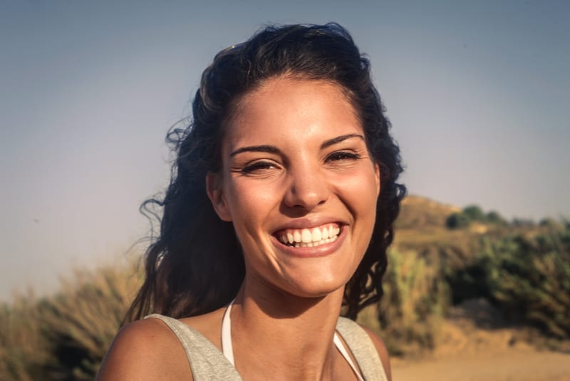Smiling happy woman outdoors
