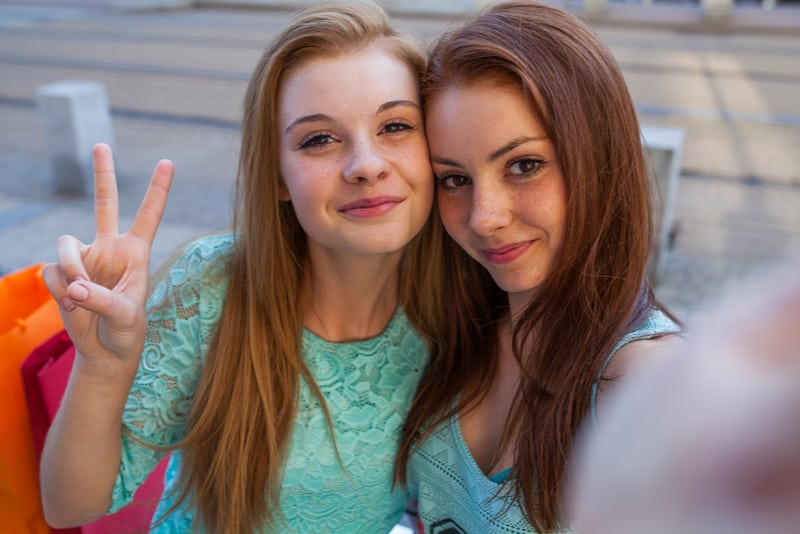 Two pretty girls taking selfie