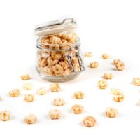 baby puffs in a glass jar in front of a white background