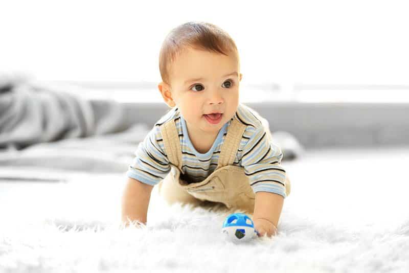 cute little boy crawling on the floor