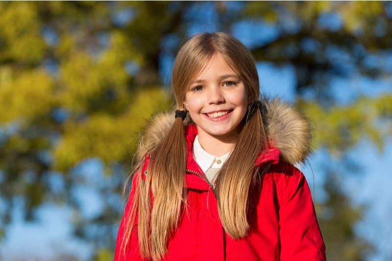 cute little girl wearing red jacket