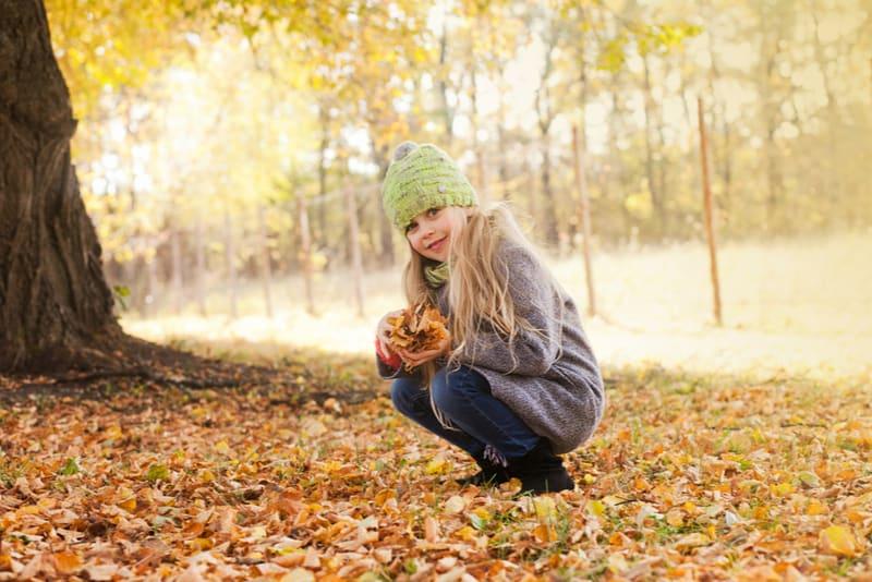 little girl in park in autumn