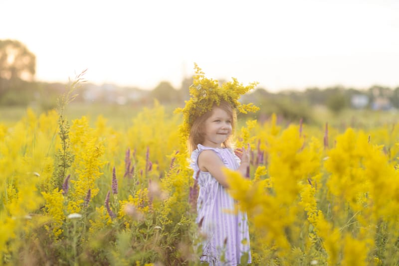 smiling little girl with beautiful floral dress