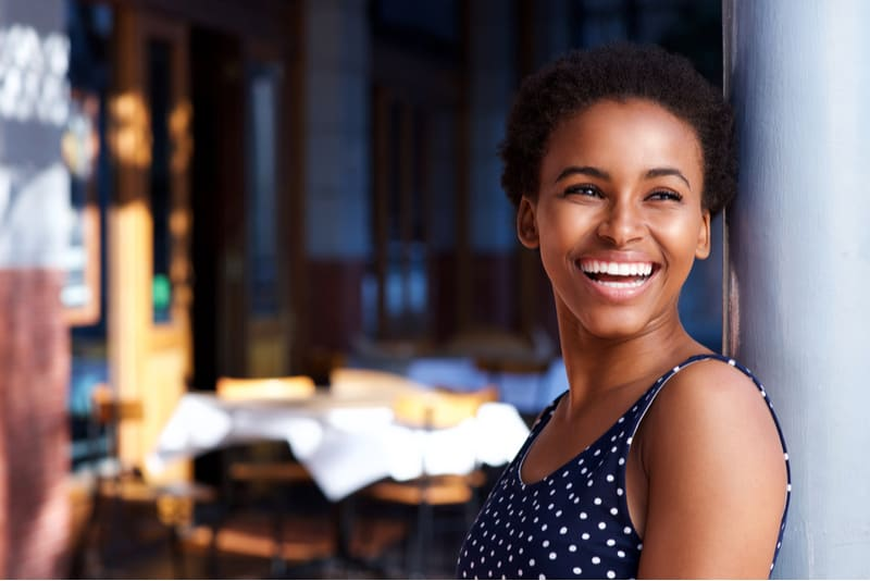 smiling young woman standing outside