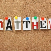 the name Matthew in colorful letters on a board