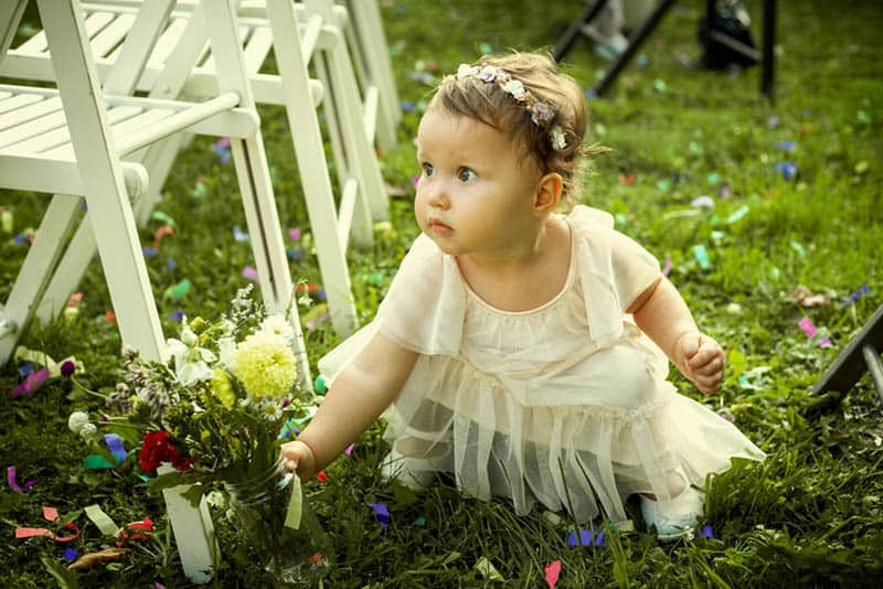 Cute little girl on a family wedding with flowers