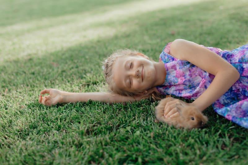 Girl is holding a cute little rabbit