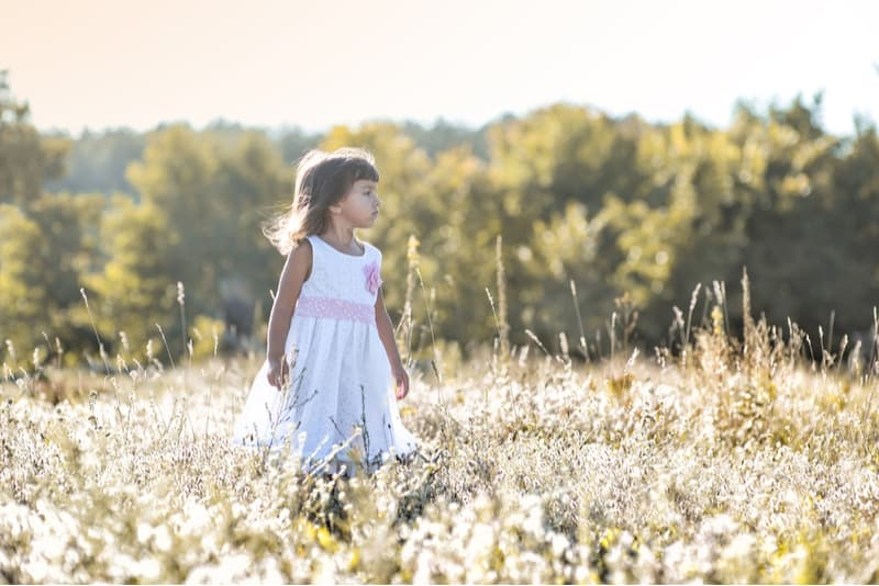 Girl on the field with wildflowers