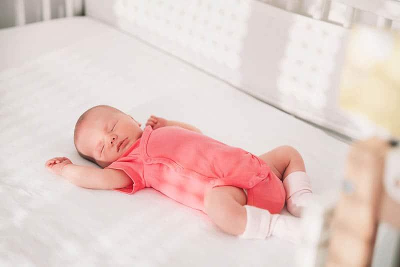 adorable baby sleeping in short sleeve suit