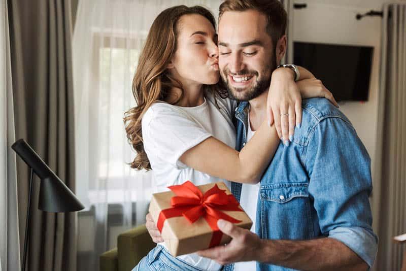 beautiful woman kissing husband for birthday