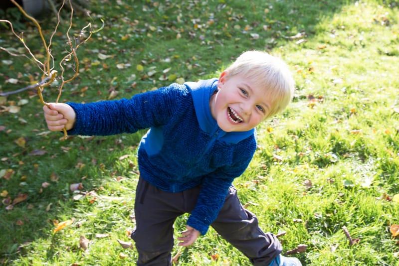 cute little blond boy smiling