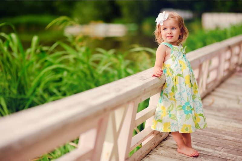 cute little girl in sunny summer day