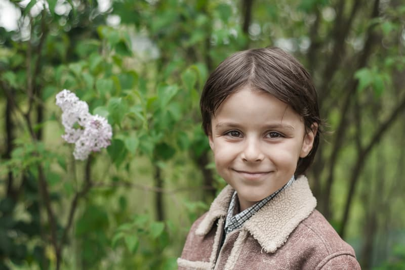 little boy smiling outdoors