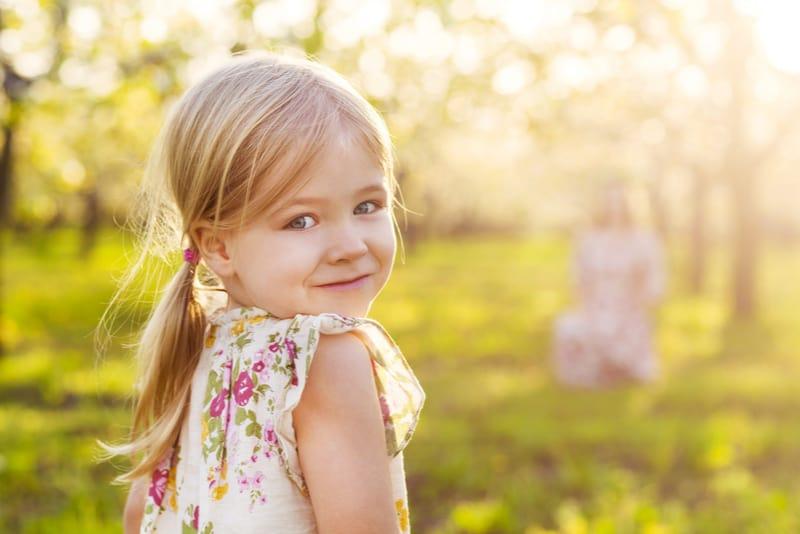 little girl in blossoming garden