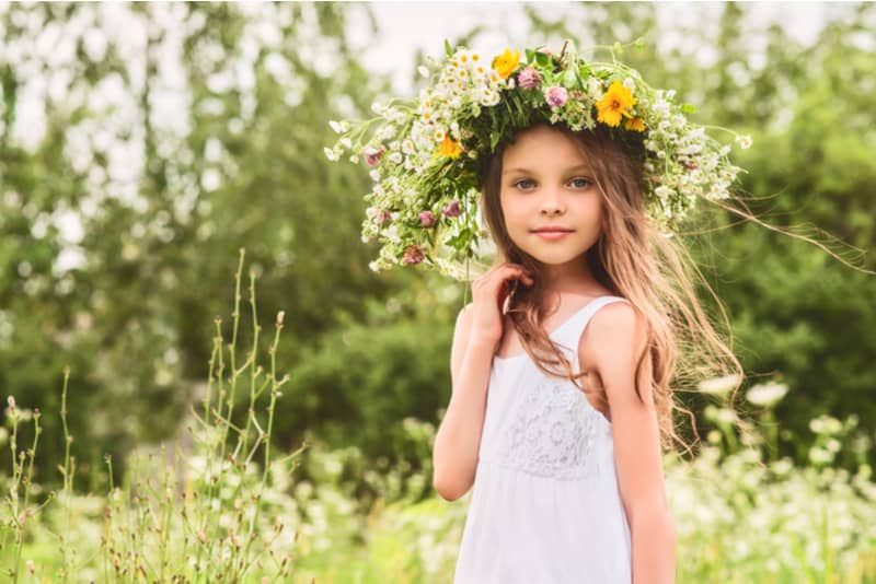 little girl with flower wreath on the head