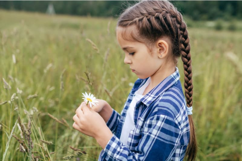 little girl with long hair wearing checkered shirt