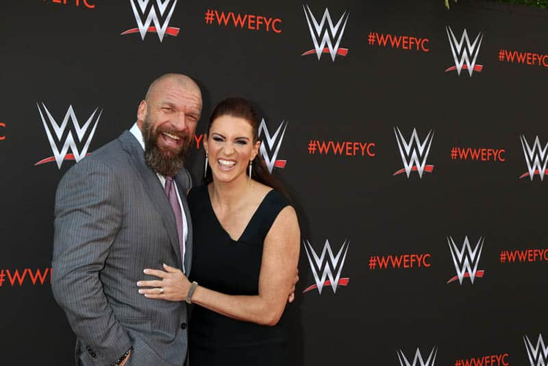 professional retired wrestler posing with man on the premiere