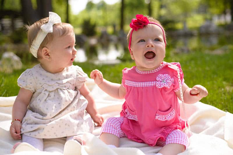Baby girls playing in the park