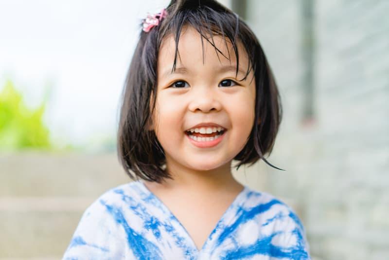 Happy little asian girl having fun
