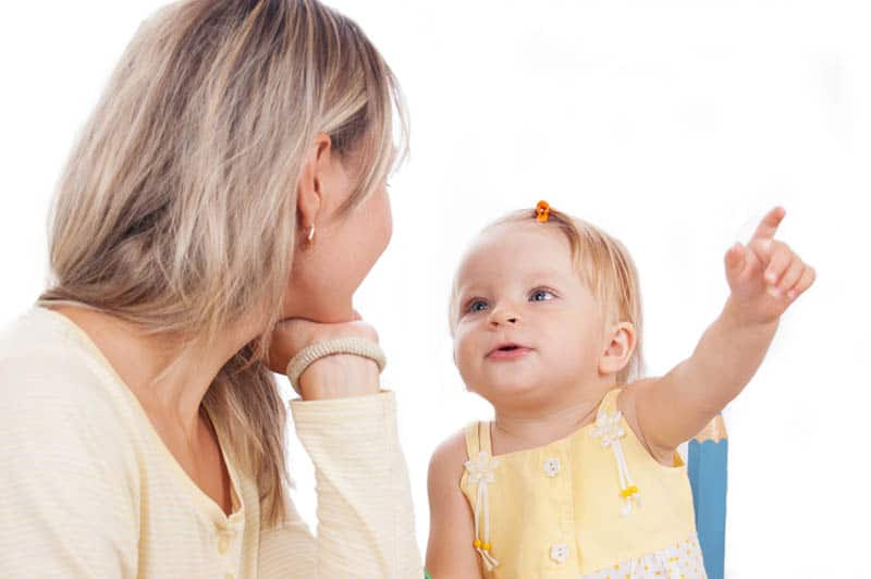 adorable little girl talking to her mother