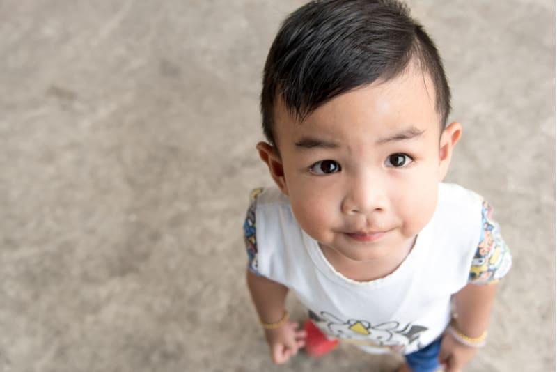asian baby boy looking at camera