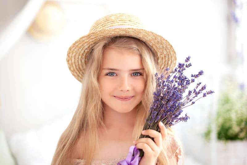 beautiful little girl holding a lavender