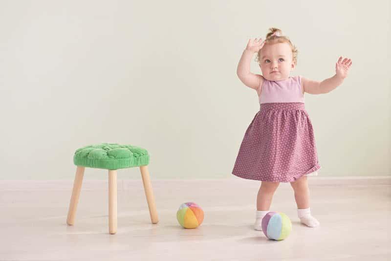 cute little girl in a pink dress dancing
